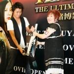 One of the winners receive prize from Tatsuya Fujiwara