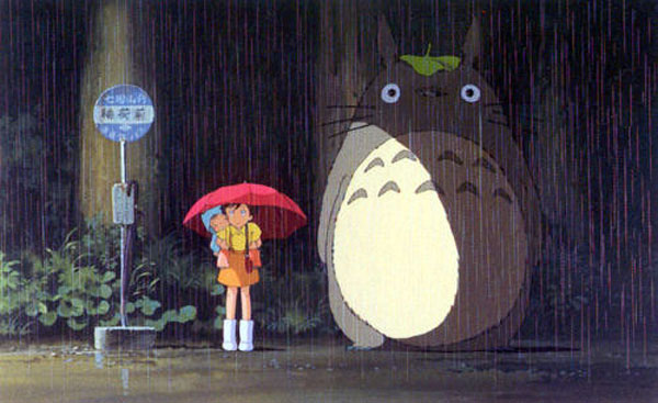 Totoro stuck in the rain with leaf on his head